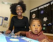 Mother and son doing crafts at Frosty and Friends.