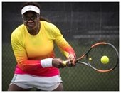 A woman playing tennis.