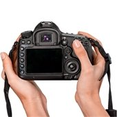 Photo of a person holding a camera.
