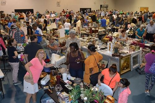Shoppers and vendors at the Indoor Yard Sale.