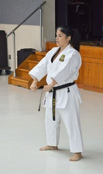 A woman in a Karate position.