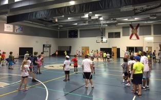 Kids playing dodgeball in Sports Camp