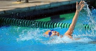 Swimmer doing the back stroke