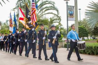 Police and Fire Honor Guard marching in to the Veterans Day Ceremony