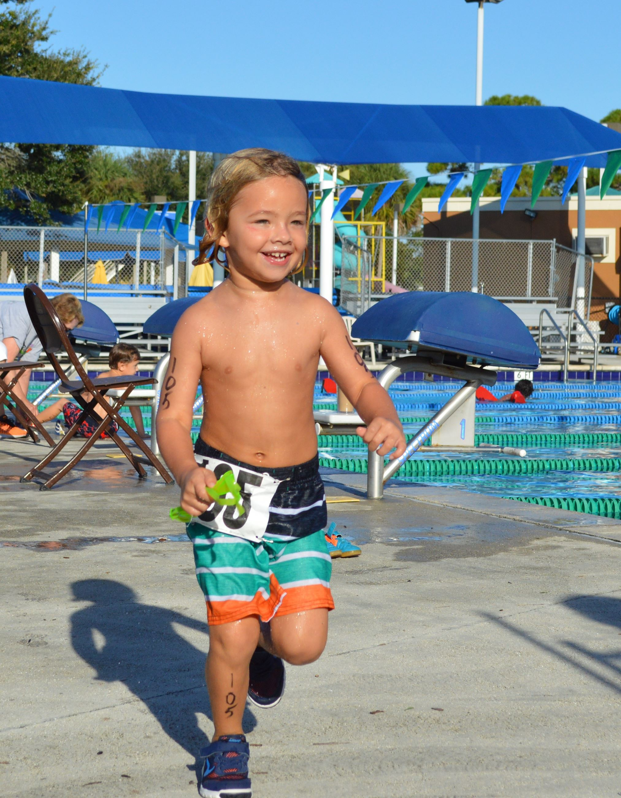 A little boy running in the Splash and Dash 2016