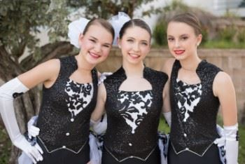 Three female dancers in dance costumes