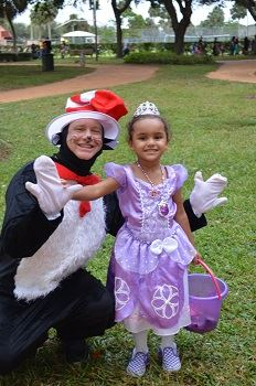 The Cat in the Hat with a young girl in a Halloween costume