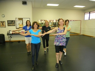 Women tap dancing during and adult tap dance class.