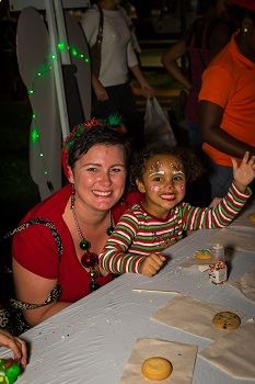 A woman and a young girl with her face painted