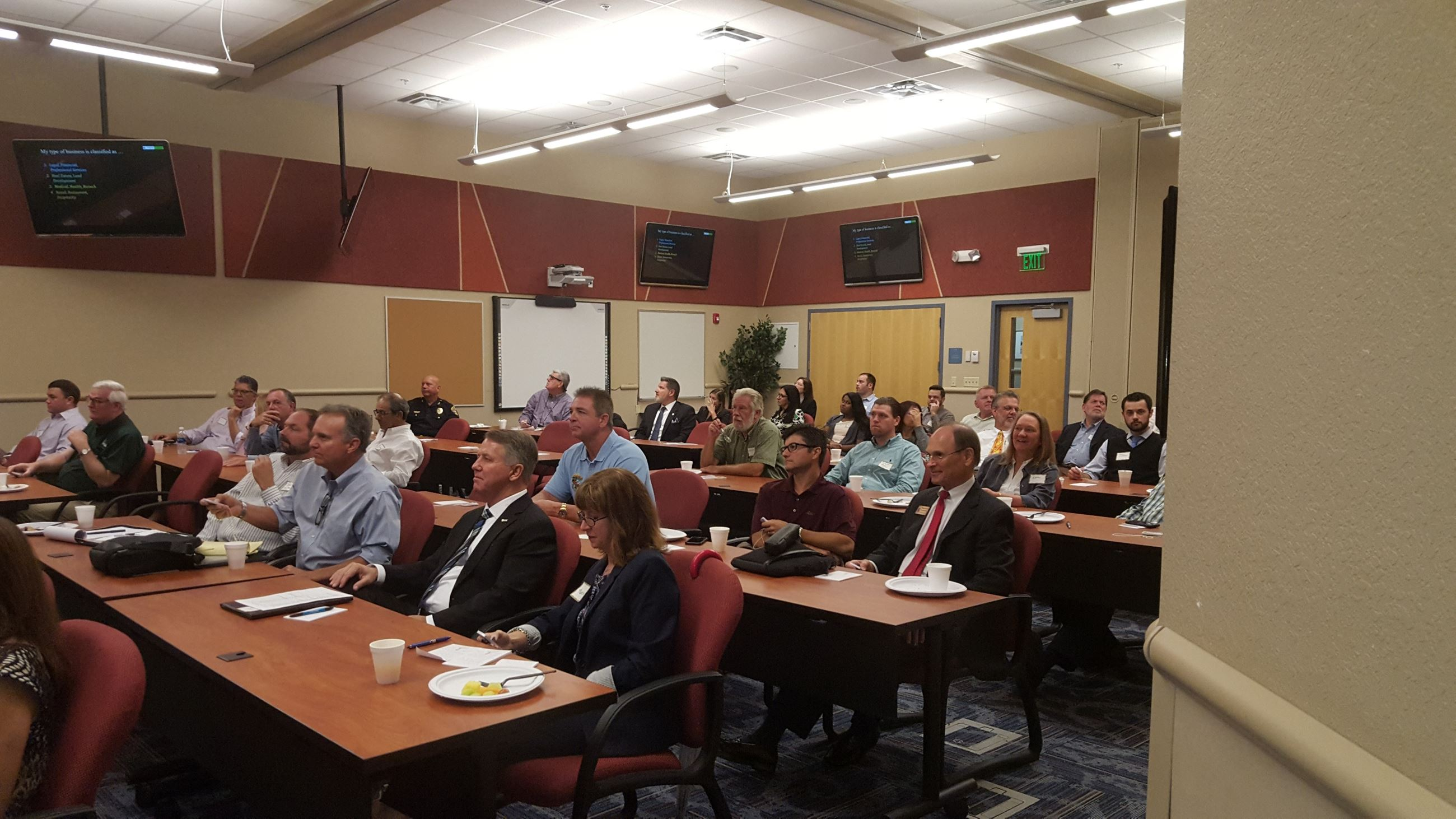 Business leaders listening to the presentation