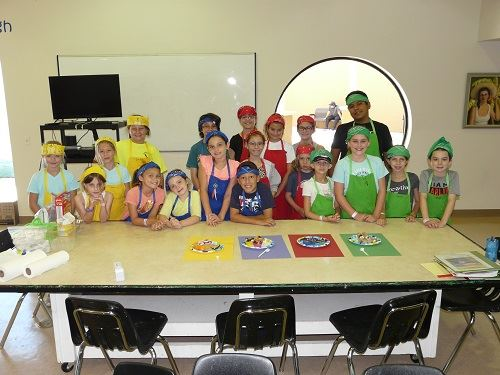 A group of kids in the Kids' Cooking Challenge camp