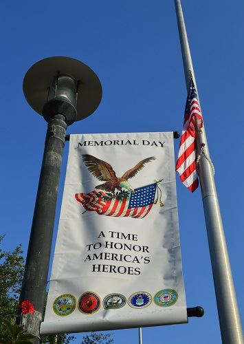Memorial Day banner on a post next to the American Flag