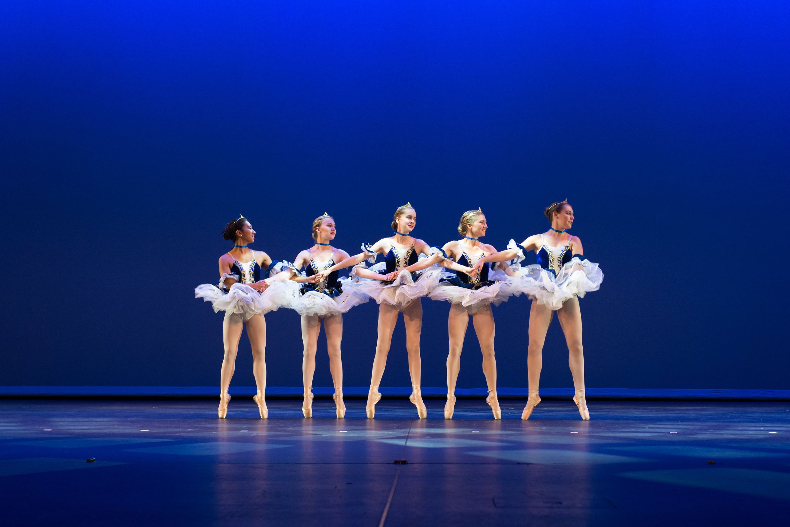 photo of young girls ballet dancing on pointe