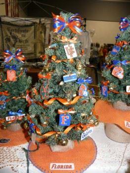 A miniature Christmas tree decorated with University of Florida colors and trinkets.