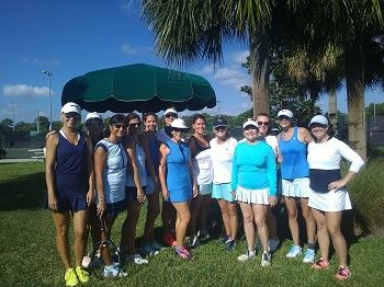 A group of ladies on the Ladies Tennis Team standing in a group.