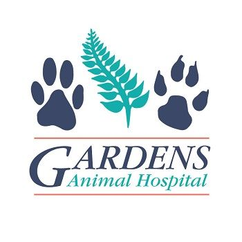 Gardens Animal Hospital logo with two paw prints and a fern leaf in the middle