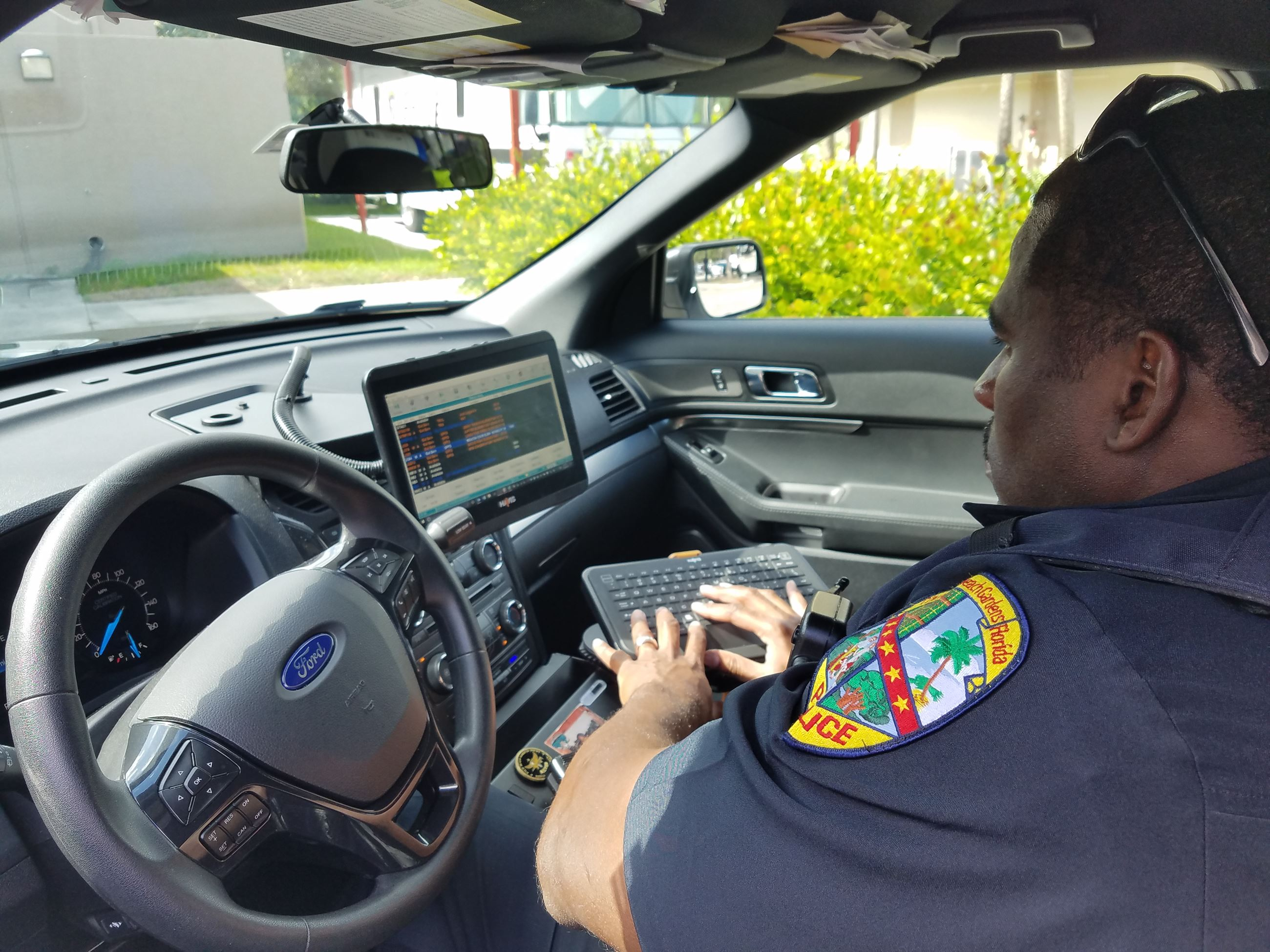 Police officer using in-car computer