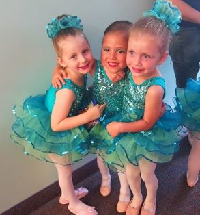 Three little dancers in costume