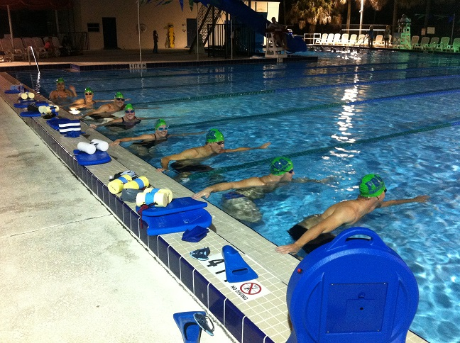 Adults participating in a water fitness class in a pool
