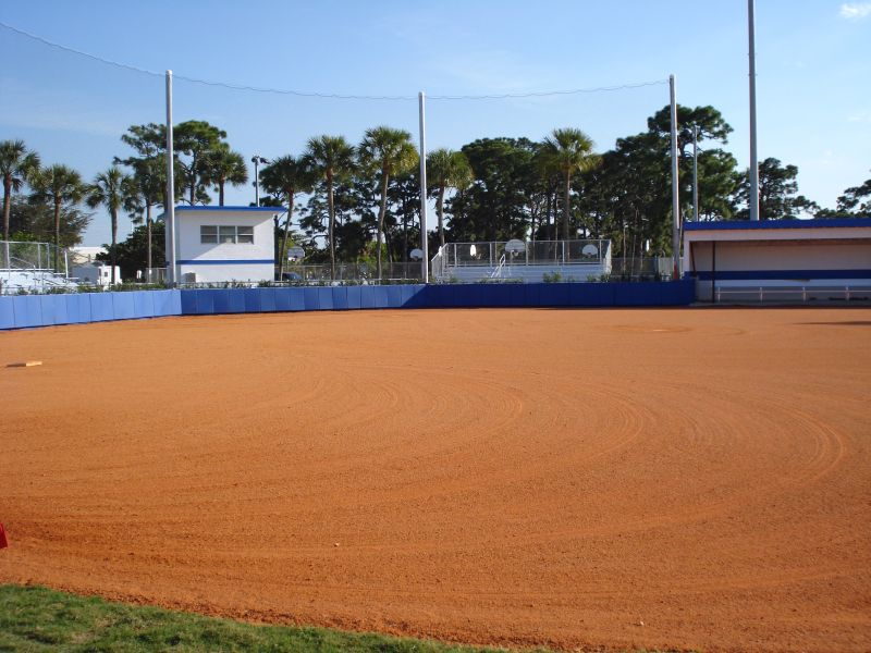 Plant Drive Park Softball Field with blue backstop and white dugouts and pressbox with blue trim