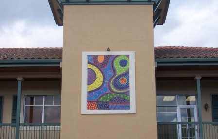 Artist's conceptual painting of bacteria in frame on side of building