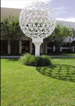 Sculpture of a large, white golf ball sitting on a tee
