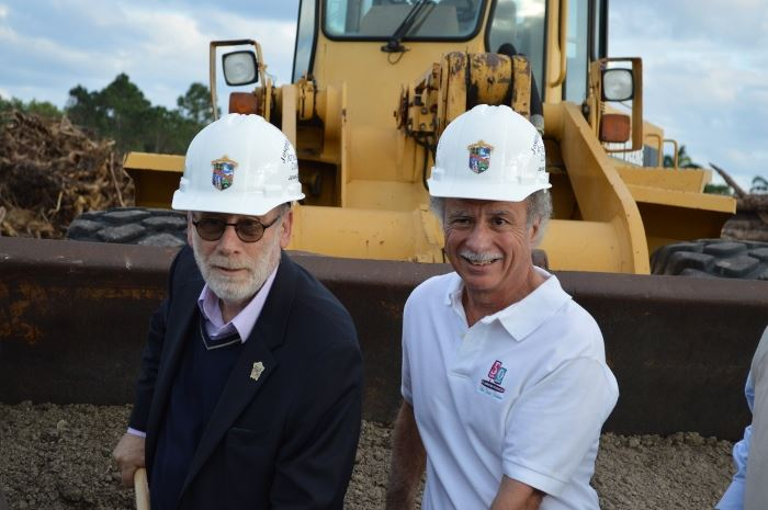 Eric Jablin and Joe Russo wearing hard hats and smiling