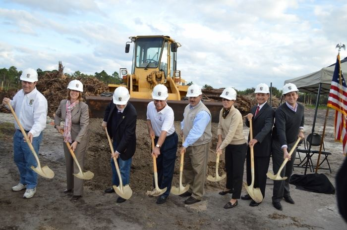 Council members and others involved in the project shoveling dirt