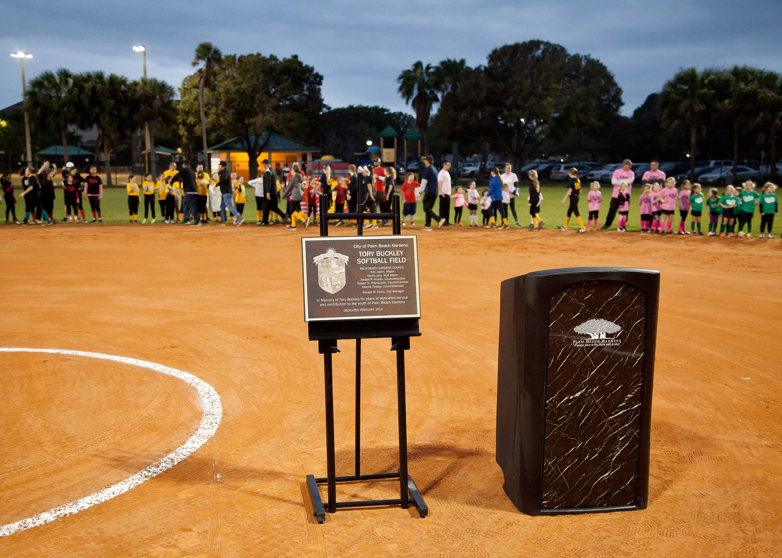 A podium and plaque on the softball field