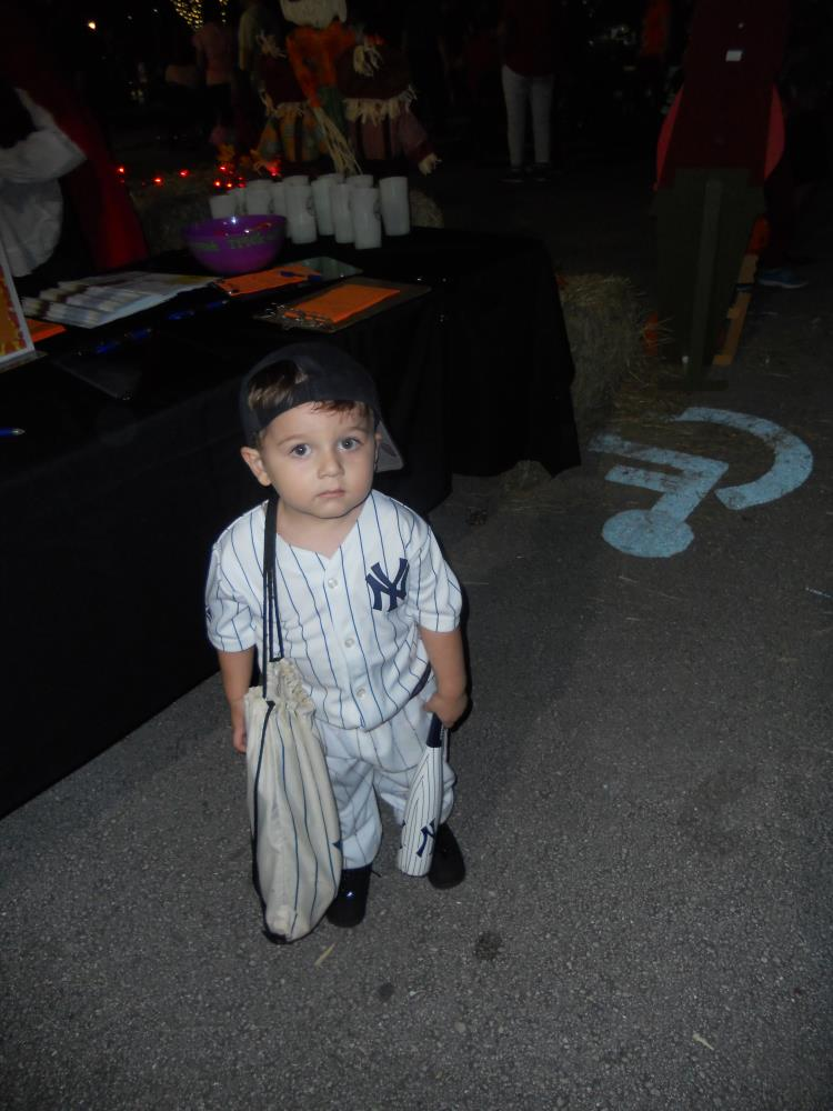 Boy dressed as New York Yankees baseball player