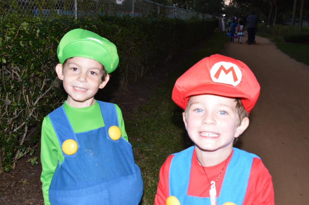 Boys dressed in Luigi and Mario costumes