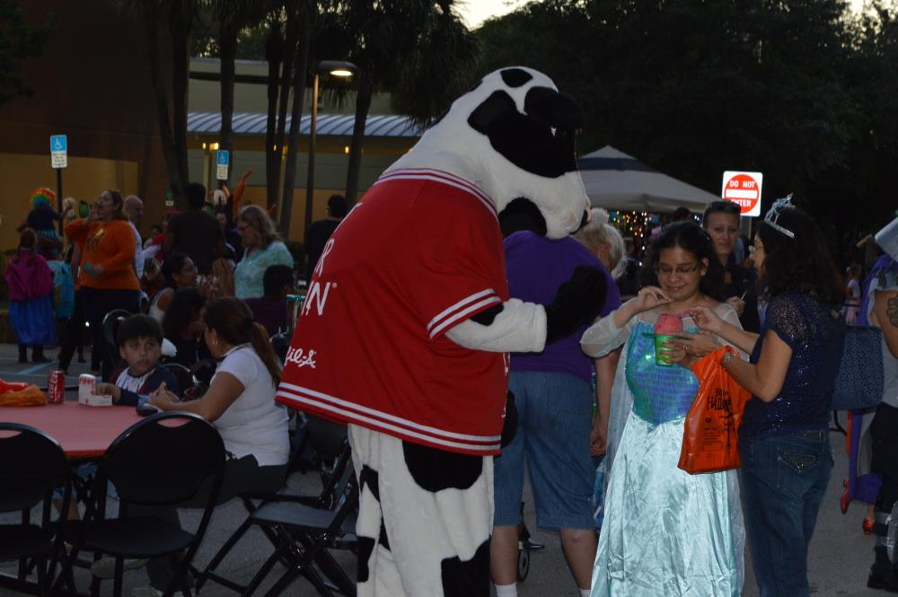 Chick-Fil-A Cow interacting with people at festival