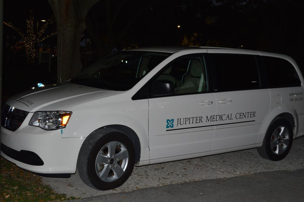 "White van with Jupiter Medical Center logo and text ""Jupiter Medical Center"" on side"